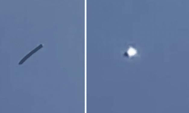 Snake-like UFO spotted again as mystery object 'emits energy beam' over Washington