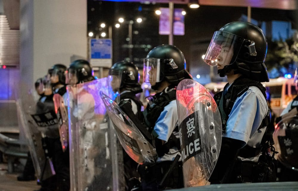 ON EDGE: Riot police storm Hong Kong airport as protesters force second day of flight cancellations