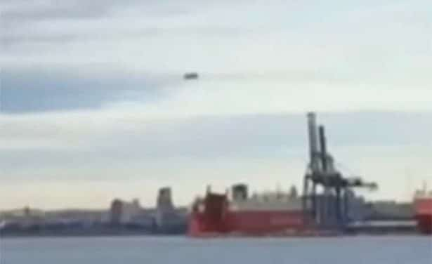 Huge cigar-shaped object 'with spheres circling it' seen hovering over Baltimore