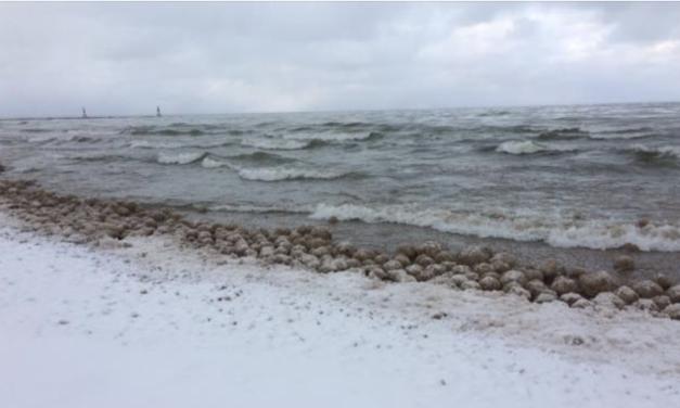 Rare ice volcanoes are erupting and ice balls washing ashore Lake Michigan