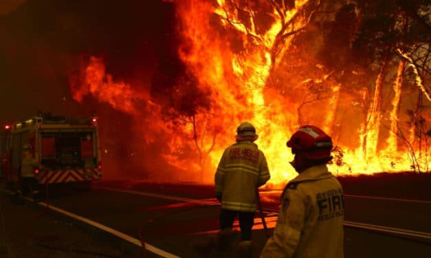 """Firefighters fleeing out-of-control blazes outside Canberra, residents scrambling to escape, officials warn of """"mega fire"""" forming close to Australia's capital city"""