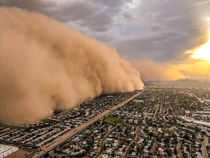 Two dust storms collide into a massive haboob impacting Phoenix area and briefly closing Interstate 10