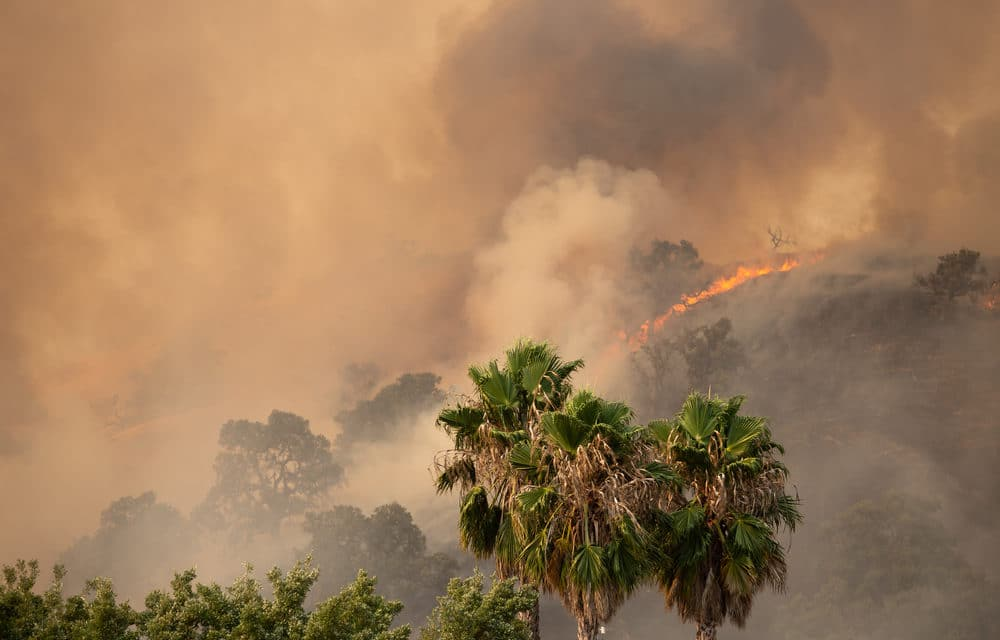 California inferno rages on claiming 6 lives and threatening thousands of homes