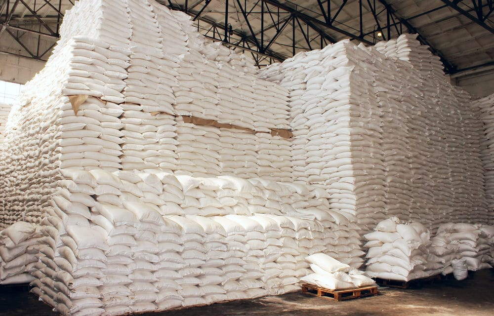Why are officials spending millions of dollars to stockpile giant mountains of food?
