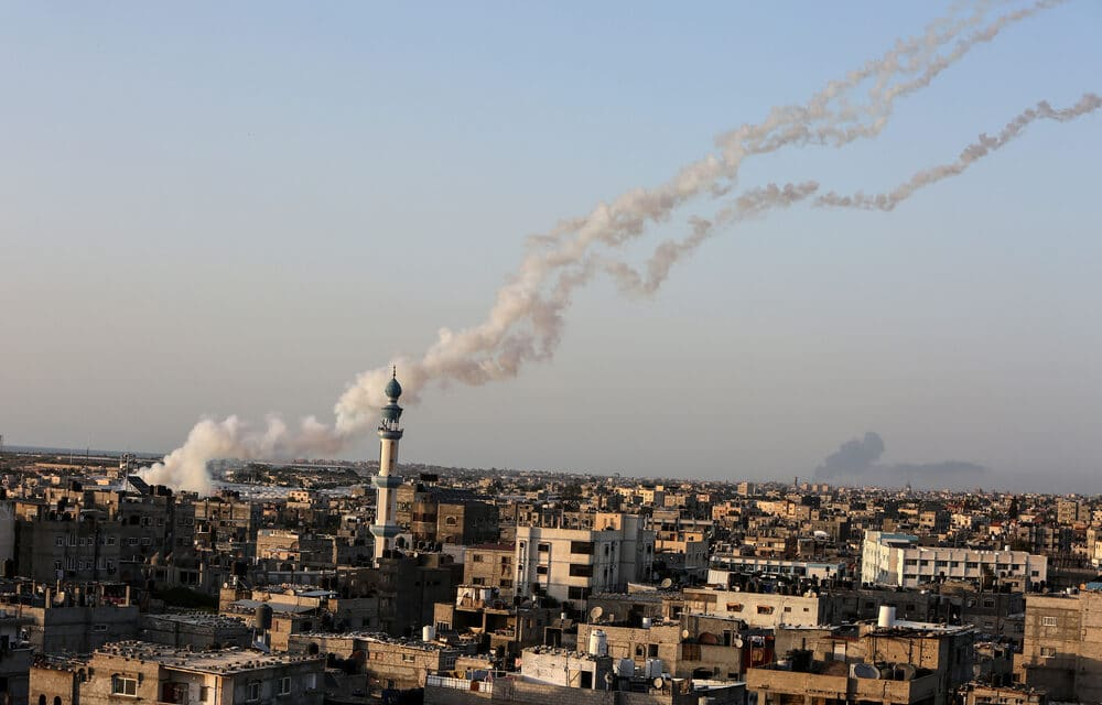 Israel strikes news media tower in Gaza, Thousands take the streets in protests